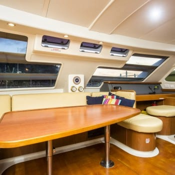 Whitsunday Escape power catamaran Leopard 47 Saloon and Navigation Table