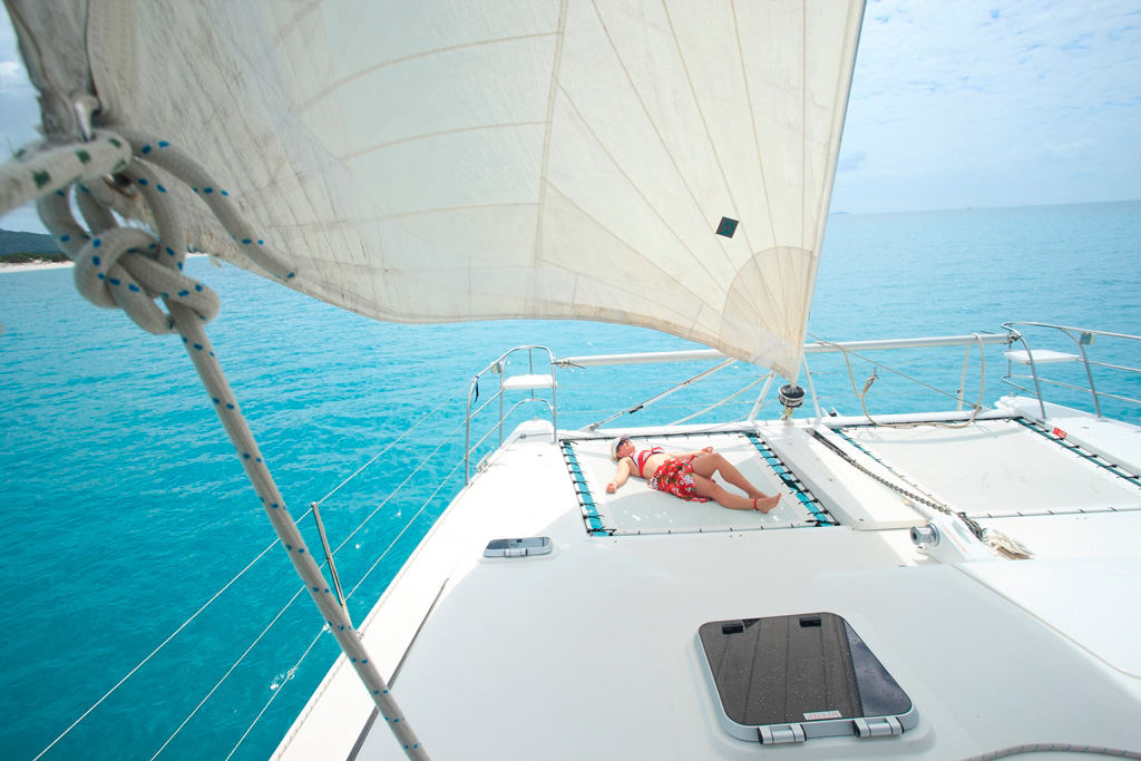 Whitsunday Escape bareboat sailing holioday sunbathing front catamaran islands bareboating in the whitsundays