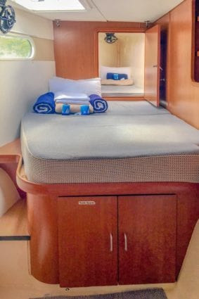 Leopard 47 Power Catamaran port forward double cabin with single bunk open