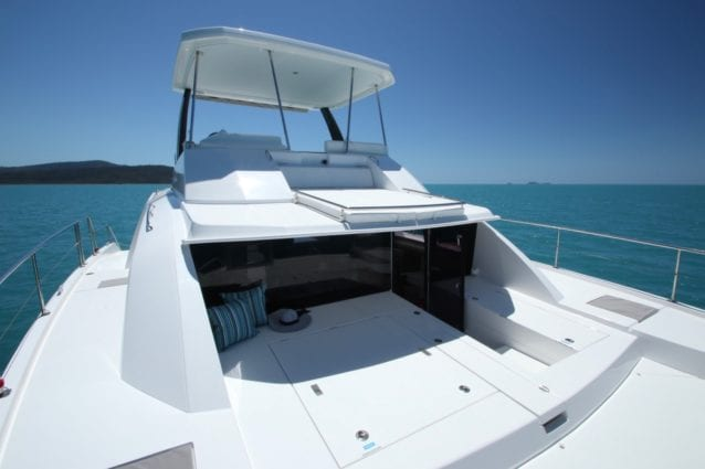 Whitsunday Escape Leopard 43 Power Catamaran Foredeck walk-through, foredeck, helm, sunbed