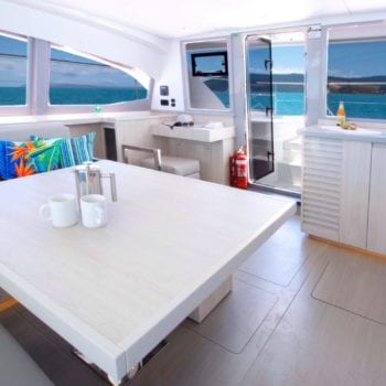 Whitsunday Escape Leopard 43 Power Catamaran Saloon galley forward door